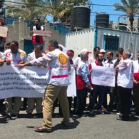 Palestinian medical volunteers protesting outside a UN office in Gaza City.