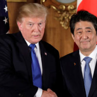 U.S. President Donald Trump, left, shakes hands with Shinzo Abe, Japan's prime minister, during a news conference at Akasaka Palace in Tokyo, Japan, November 6, 2017.   REUTERS/Kiyoshi Ota/Pool